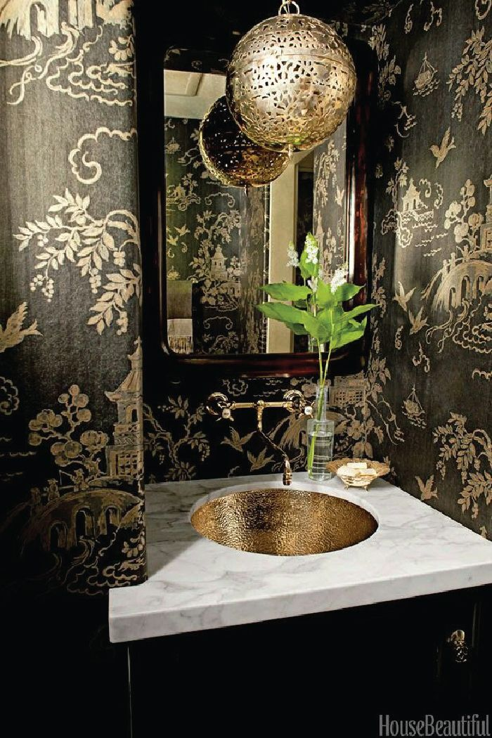 A powder room is the perfect place to use statement wallpaper. It's small (and therefore budget-friendly), and it's generally a room reserved exclusively for visitors, so it's a perfect place to show off your sense of style. Statement wallpaper in a powder room via House Beautiful - Designed by Betsy Burnham - photo by Amy Neunsinger