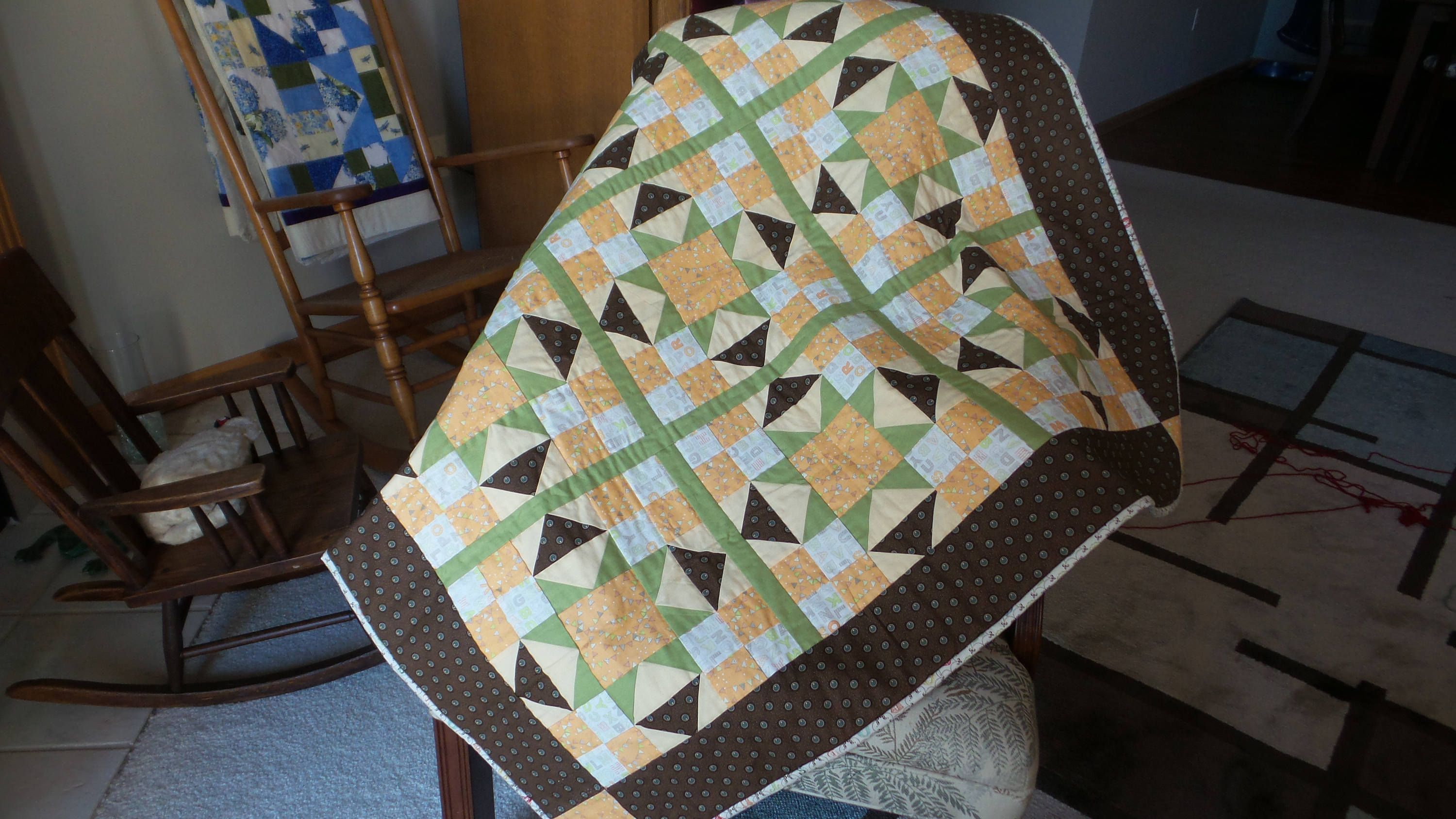Alphabet baby quilt in brown and pale green and soft orange by LadyInStitches on Etsy