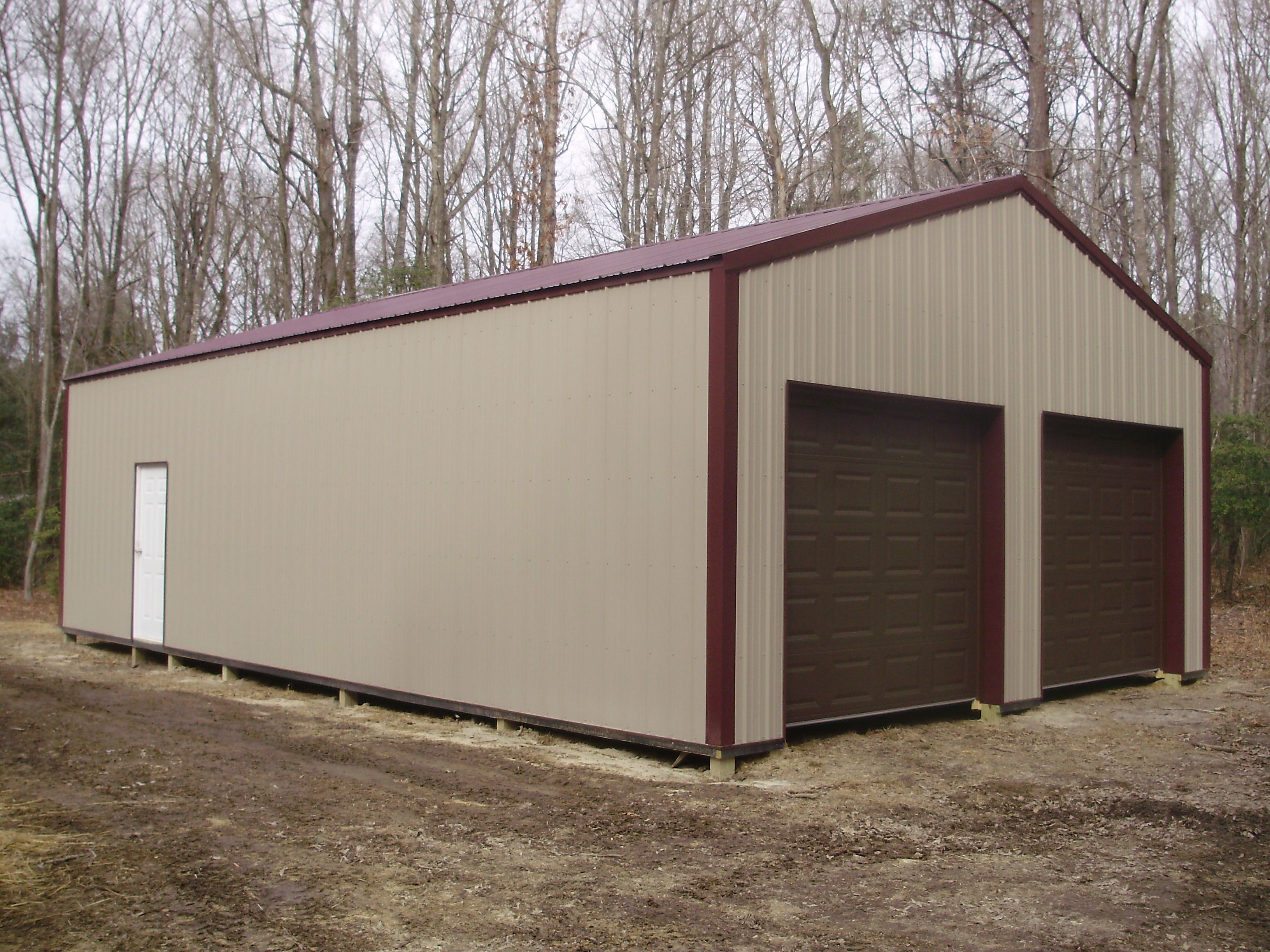 24 W X 40 L X 10 4 H Pioneer Pole Buildings Garage With Brown Overhead Doors Pole Building Garage Garage Door Design Pole Buildings