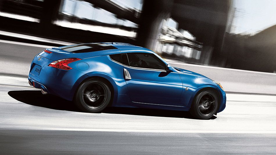 2015 370Z® COUPE Touring shown in Midnight Blue Nissan