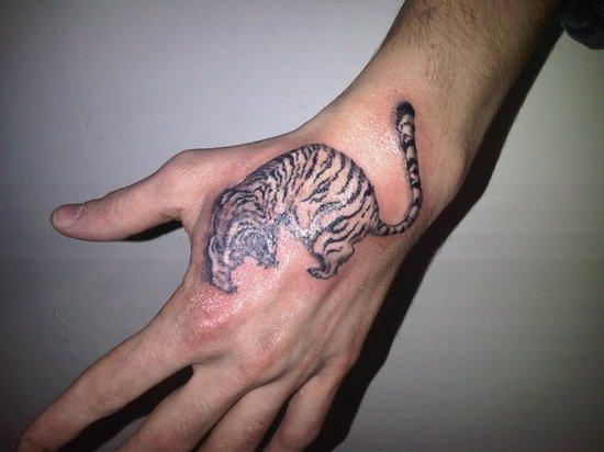 Small Tiger Tattoo On Hand Animal Tattoos For Men Hand Tattoos For Guys Hand Tattoos