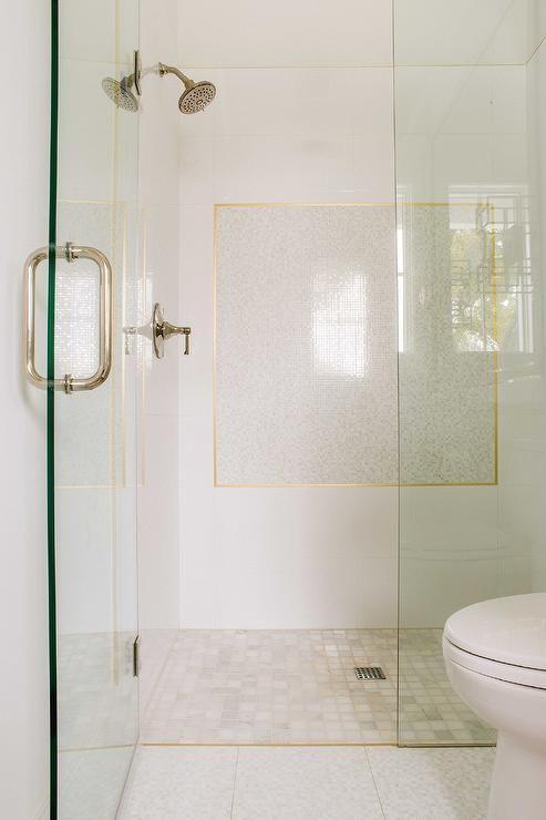 Stunning walk in shower is clad in honed marble grid floor tiles ...