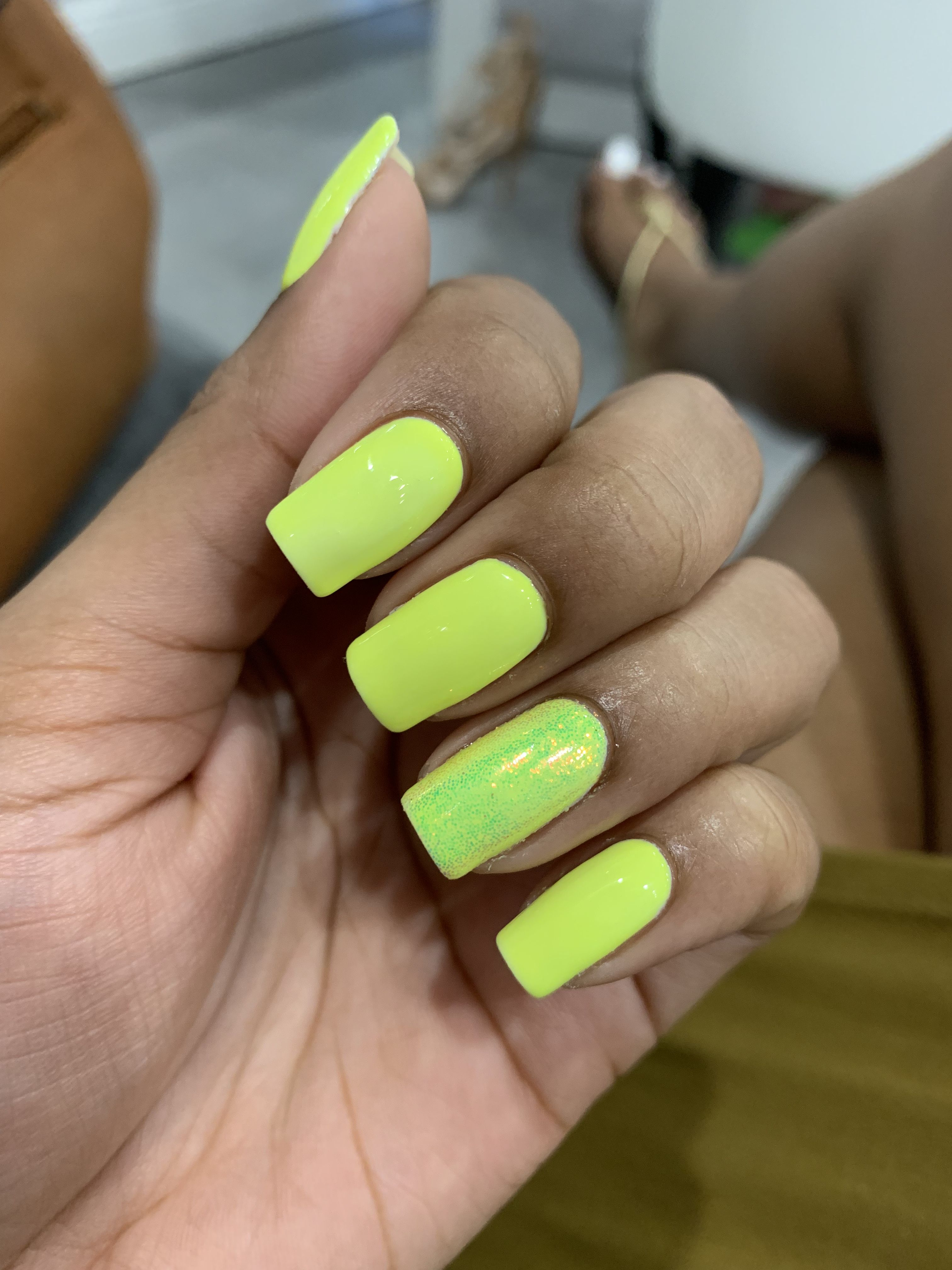 Neon Yellow Gel Nail Polish With Unicorn Glitter Accents On