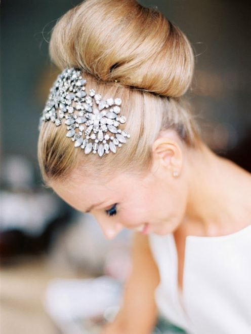A shiny hair piece to add glamour on your wedding day is the perfect accessory.