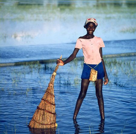 Young girl with her fishing basket in Namibia...