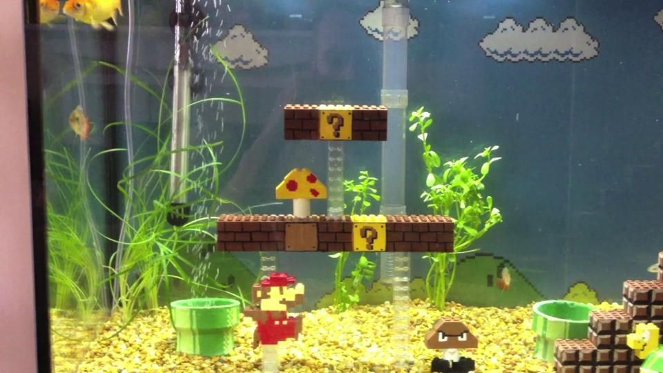 Mario Fish Tank All Of The Parts Are Made Out Of Legos Or At Least It Looks Like It Really Good Idea For Fish Tank Fish Tank Decorations Cool Fish Tanks