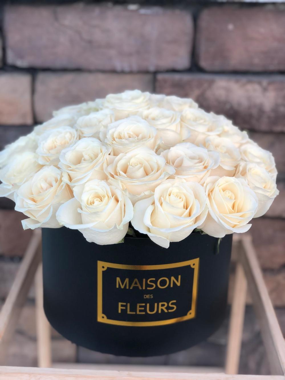 White roses in a black box. Flower White roses
