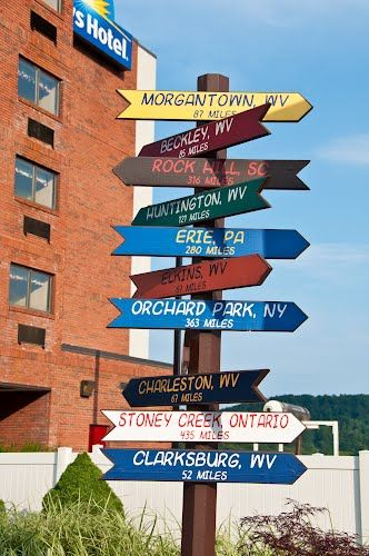 Sutton, WV / Distance Signs at Days Hotel, Flatwoods, WV