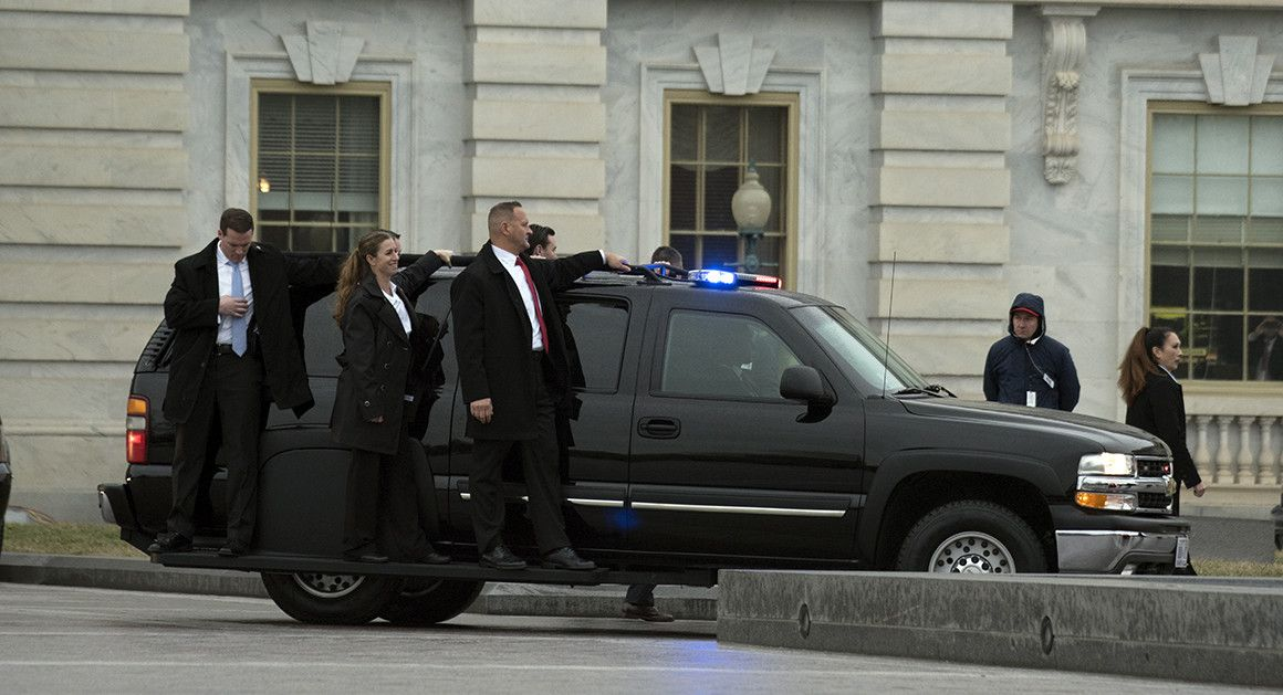 A Secret Service detail is carried on an SUV just behind