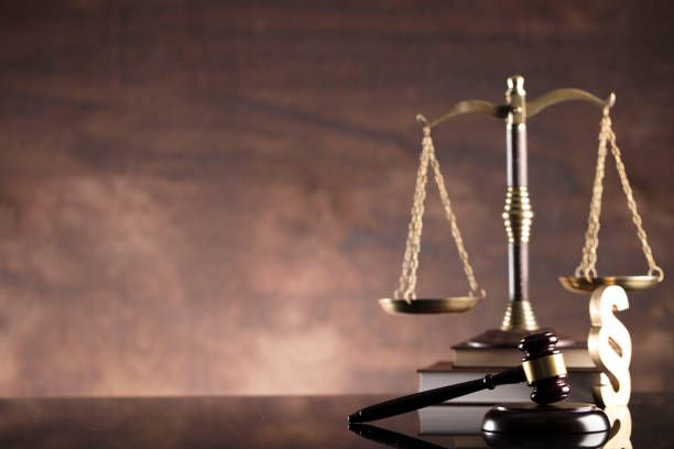 law scales of justice books gavel