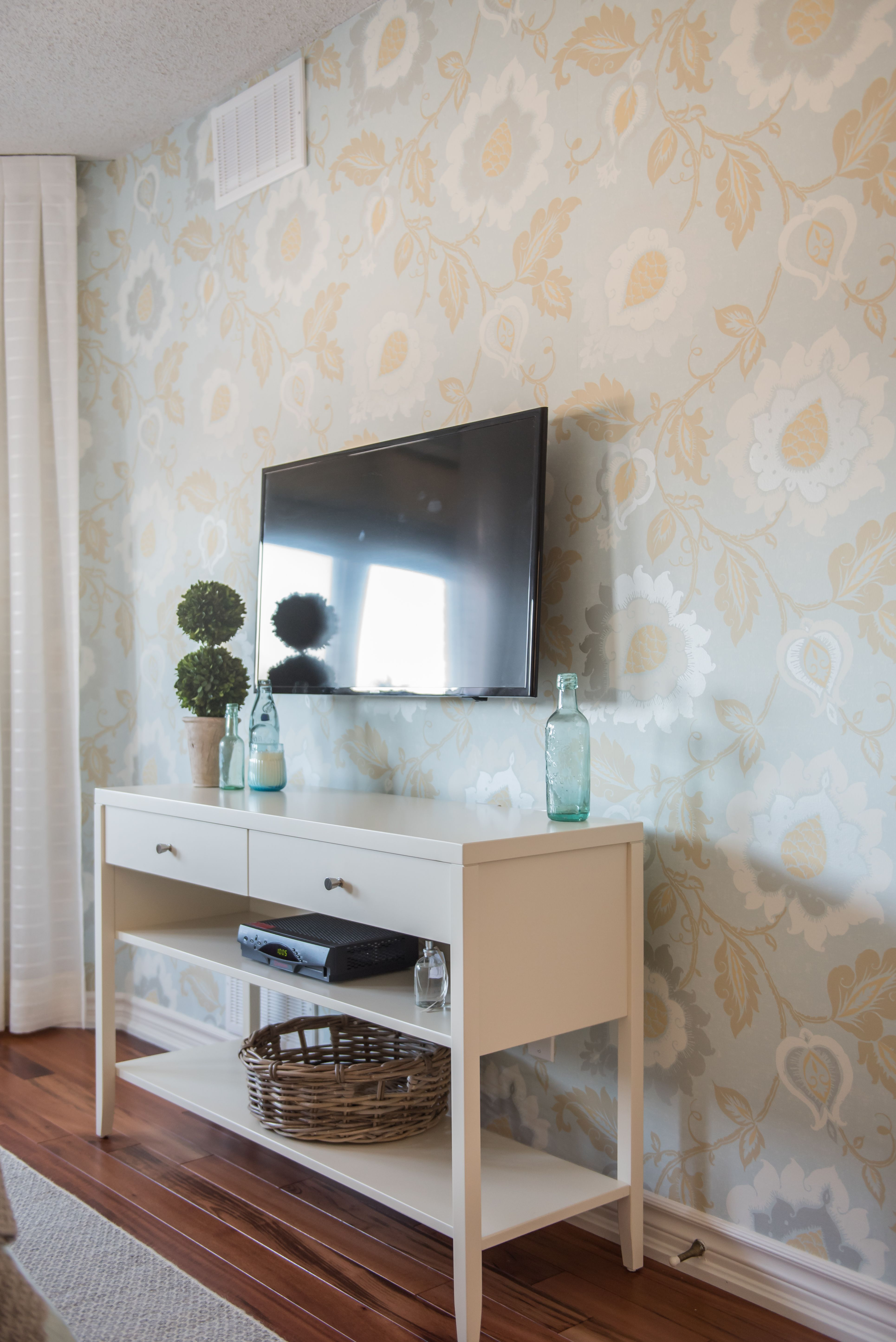 Bold wallpaper and a soft colour story lend a casual