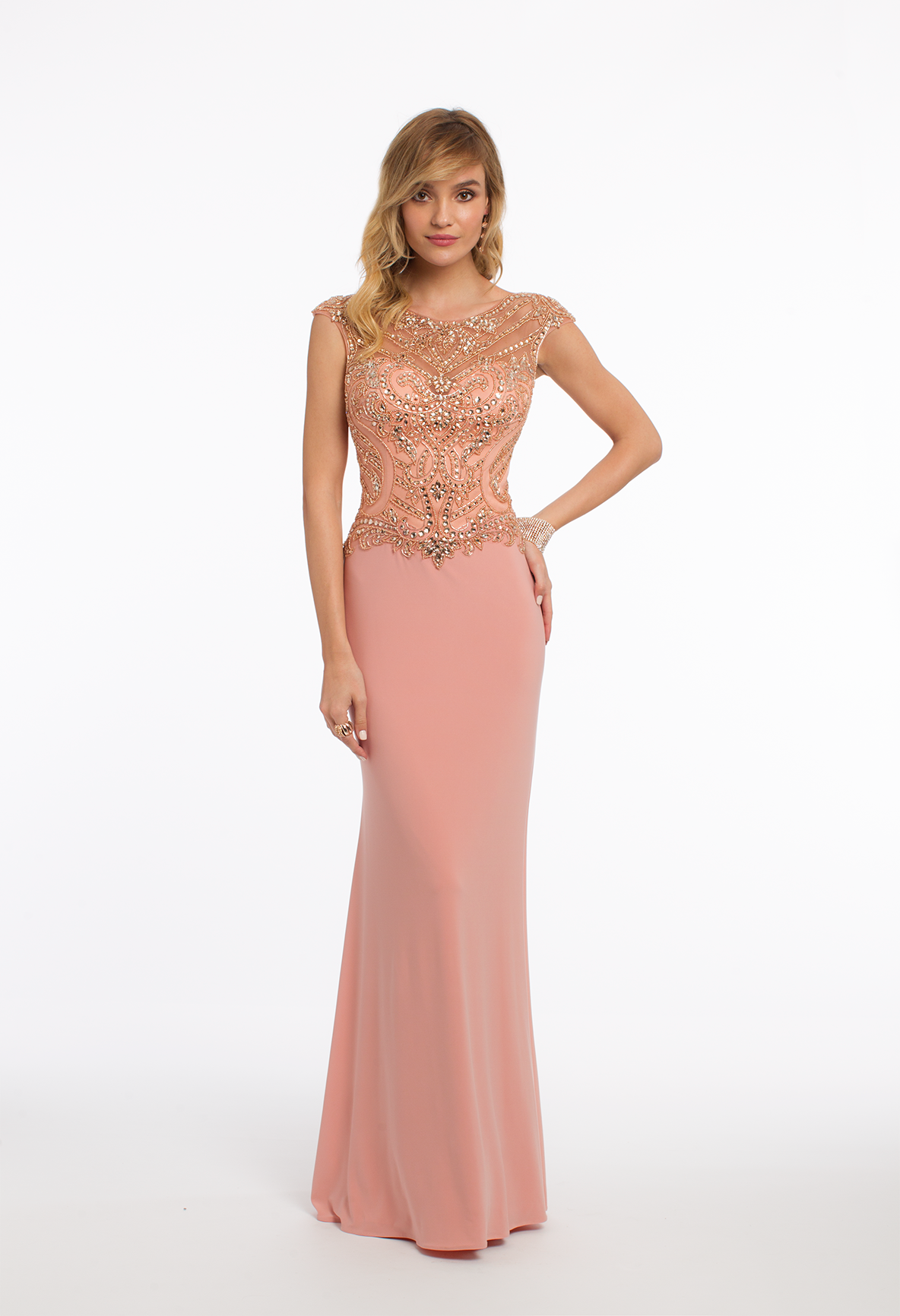 15db0502291 This formal evening gown finds the balance between simplicity and  statement  The illusion beaded neckline