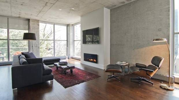 Dark hardwood floor exposed concrete ceiling lofts for Condo ceiling design
