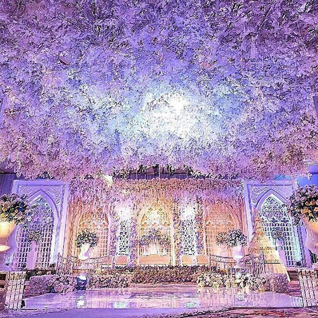 The lush floral covered ceiling at this jakarta indonesia summer wedding ideas junglespirit Images