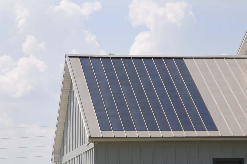 The Photovoltaic Panels In This Building Have Been Integrated Into The Standing Seam Metal Roof Photograph Via Fabral Solar Panels Metal Roof Solar Roof
