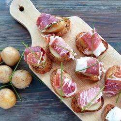 Prosciutto ham & potato on crostini.  What great color!