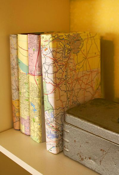 *using maps to cover books, love this look for a bookcase display