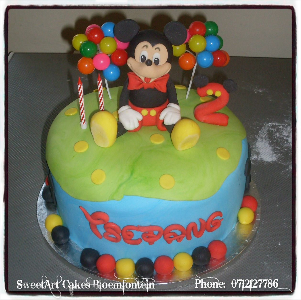 Mickey mouse cake for more info orders email
