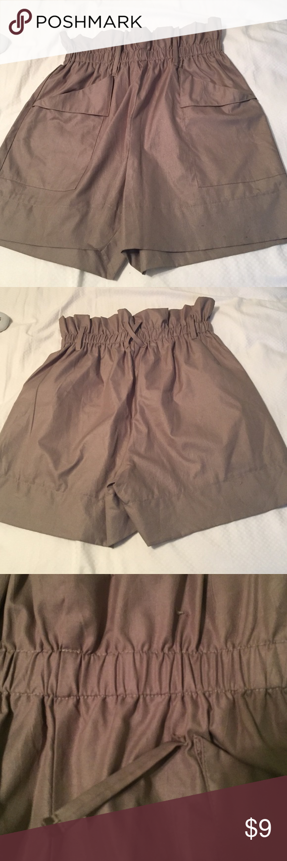 Olive high waisted dress shorts Beautiful shorts for fall with stockings and booties! More of a pale olive green than shown in pictures! One of the bucket loops needs to be sewn as shown in pictures! Priced to sell!! Shorts