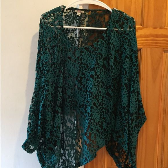 🎀Crocheted Teal Top Beautifully designed Teal Crocheted Top with Black Mesh made by Body Language. One size fits all! Ladies this is one of a kind so don't pass this up. Condition is excellent! Body Language Tops