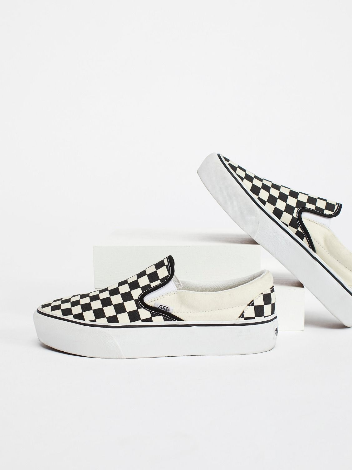 871d5a2ddd Vans Black   White Checker Classic Platform Slip-On Sneaker at Free People  Clothing Boutique