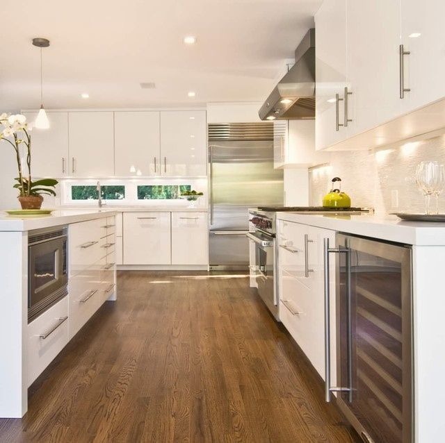 Lacquer white cabinets make this kitchen look modern and spectacular