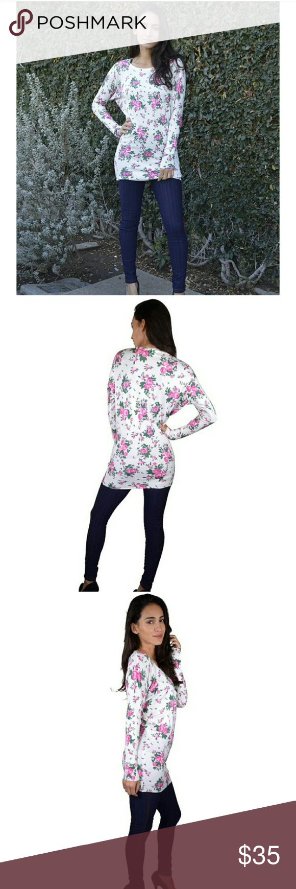 Gorgeous Floral Long Sleeve Top This beauty was hand picked by me as a *NEW * item. This is 65% Cotton/ 35%Polyester. Perfect for Spring or Easter!!! Boutique  Tops Tees - Long Sleeve