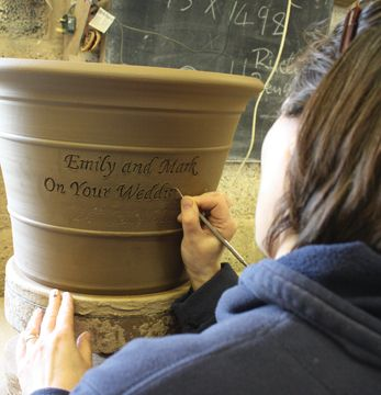 Unique pots with the inscription of your choice (such as a wedding anniversary message, pictured above) are also available at Whichford Pottery.