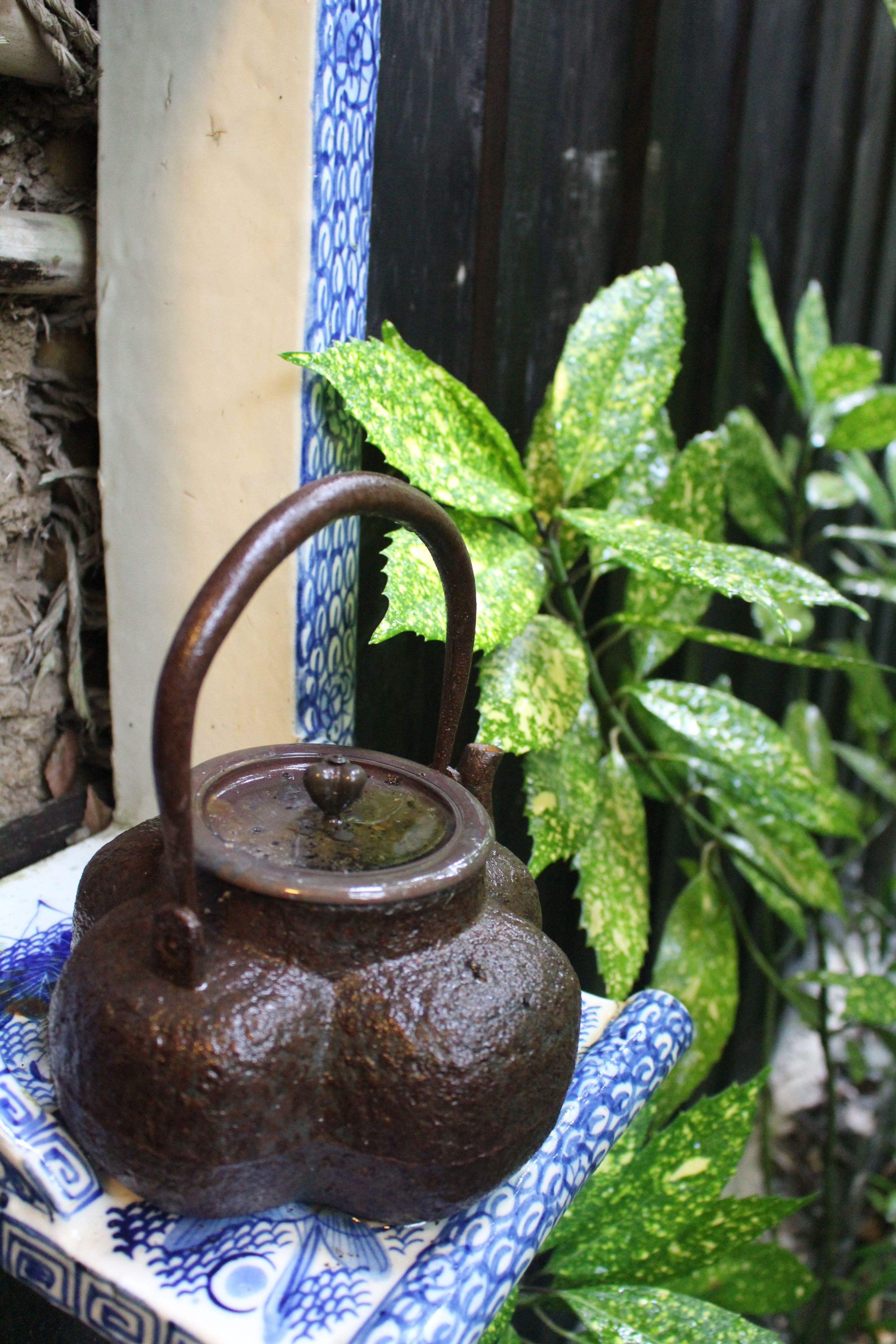 Tea pot in flont of door