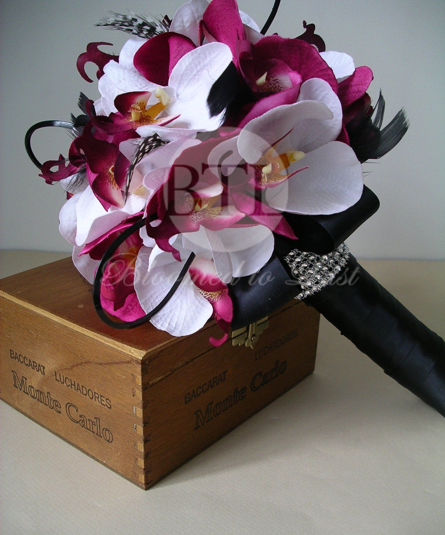 Glamorous wedding bouquet with colors of orchids feathers and