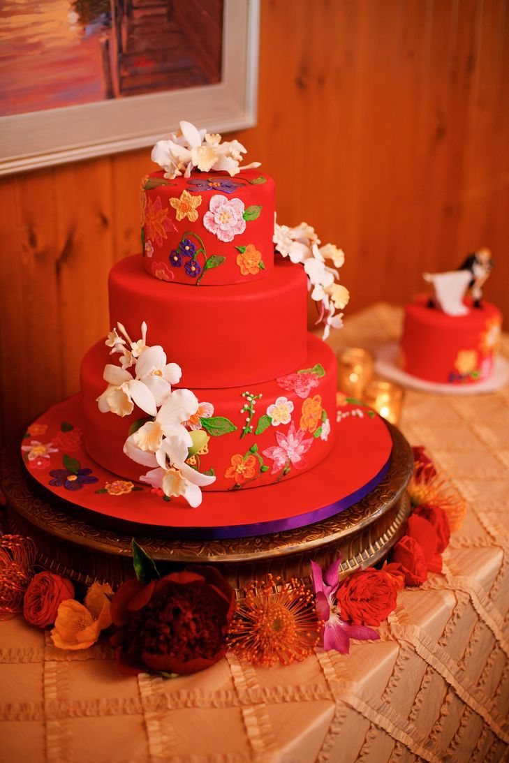 Bright red cake with white fondant orchids latest wedding trends