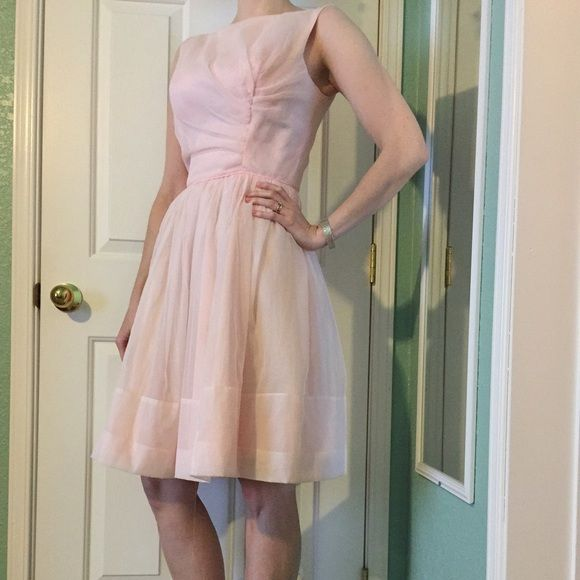 Vintage 1950's chiffon party dress Pale pink vintage 1950's chiffon party dress.  High neck, v in back.  Fully lined, no tags, polyester.  Sheer pink layer over pink lining.  Fitted bodice full skirt.  Tulle under skirting has been cut out of the full skirt, sheer top layer has pulled out from skirt around zipper, missing the eye closures from both hook and eyes, located at waist and back.  Wearable condition.  No stains, smell.  All defects easily fixed.  I'm a size 2 32d and can zip this…