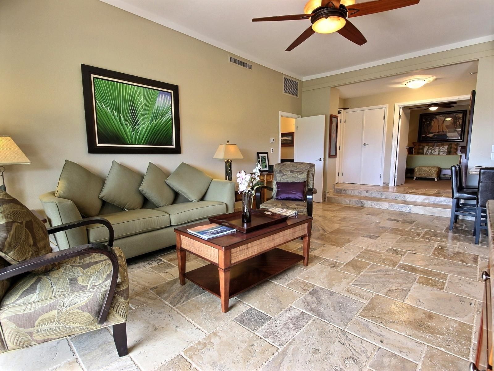 1 tag Traditional Living Room with Ceiling fan, travertine tile floors,  Built-in bookshelf,