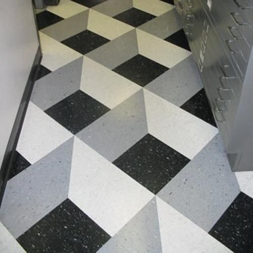Creative Vct Floor Using A Variety Of Colors And Shapes Which