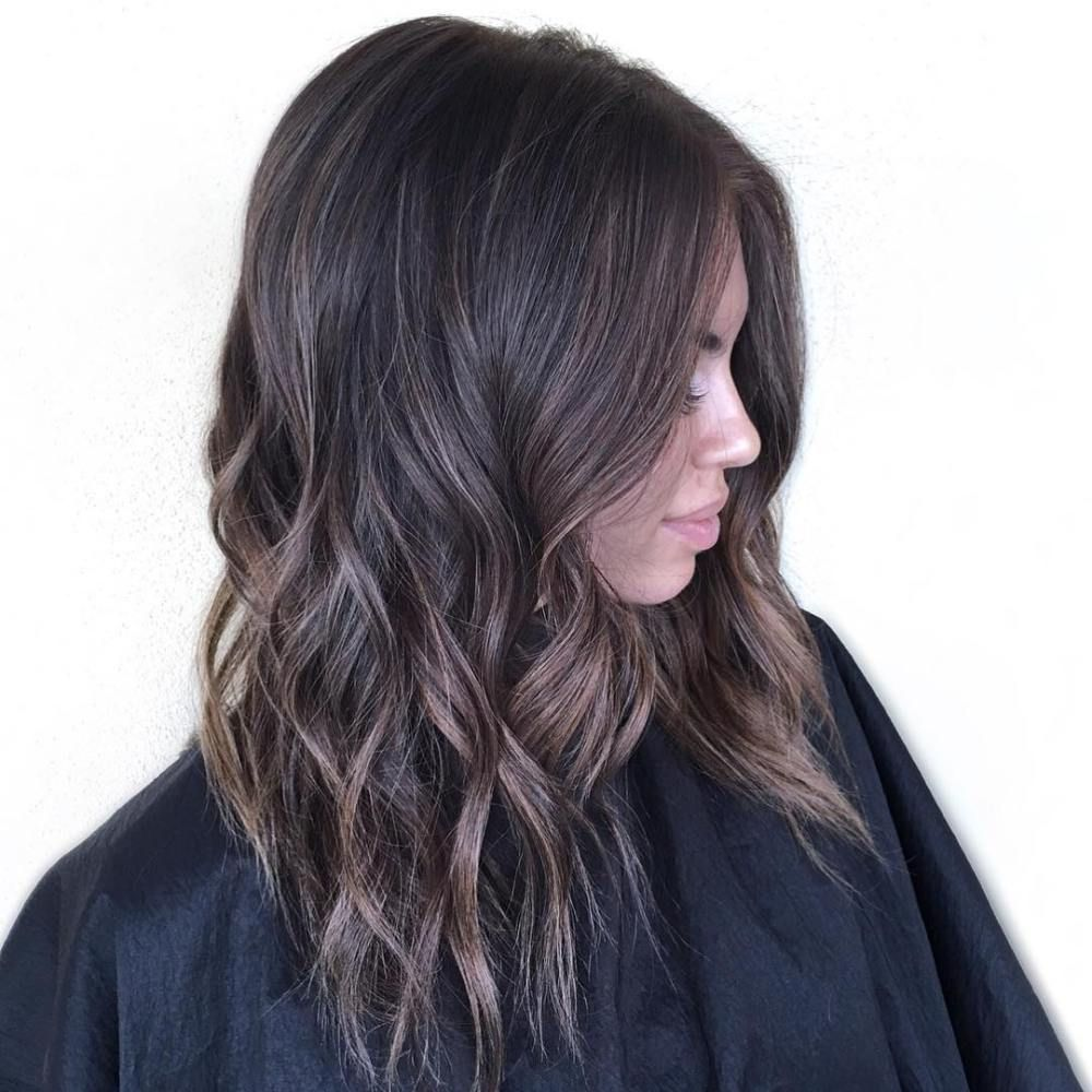 Medium Wavy Brown Hairstyle With Subtle