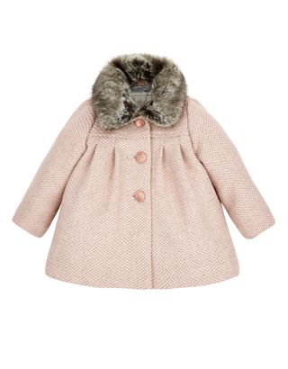 Keep it cute and cosy with our Annie tweed coat for baby girls, adorned with a detachable faux fur collar. This pretty piece has three button fastenings on t...