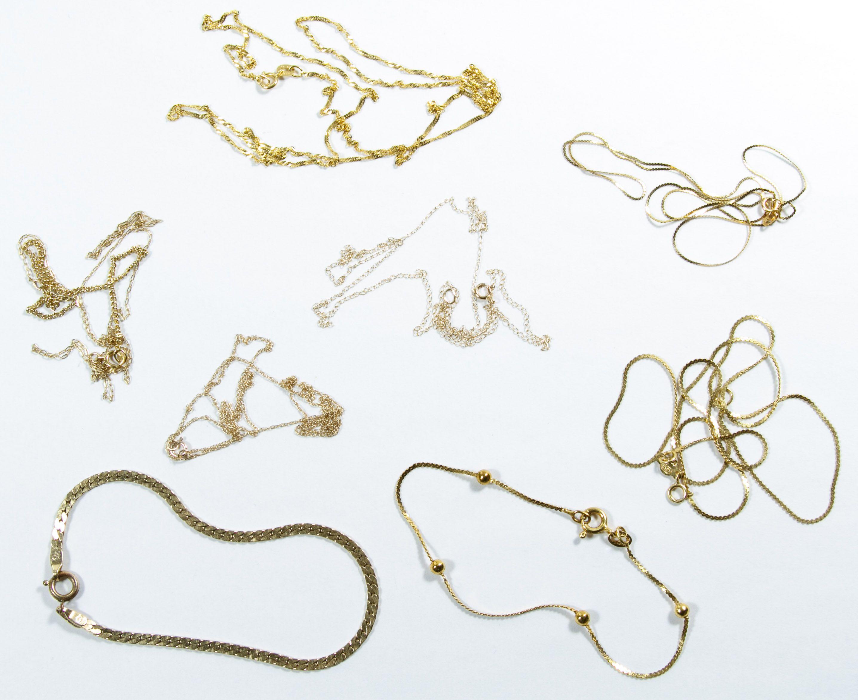 Lot 135: 14k Gold Necklace and Bracelet Assortment; Seven necklaces and two bracelets; each have stamped 14k gold marks