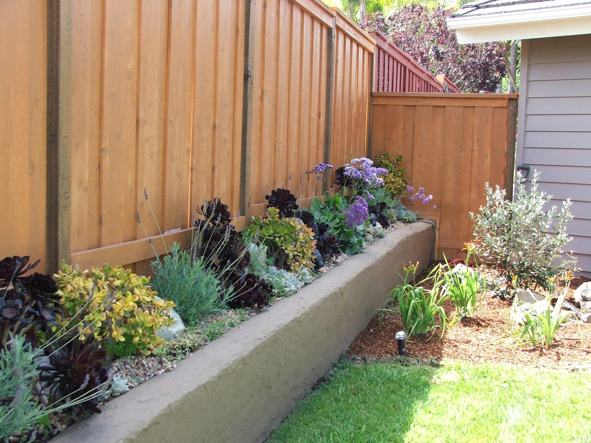 Fence with raised planter garden ideas pinterest for Yard planter ideas
