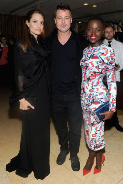 Triple Threat: Angelina Jolie, Brad Pitt and Lupita Nyong'o attend the 12 Years A Slave pre-Oscars dinner hosted by GREY GOOSE
