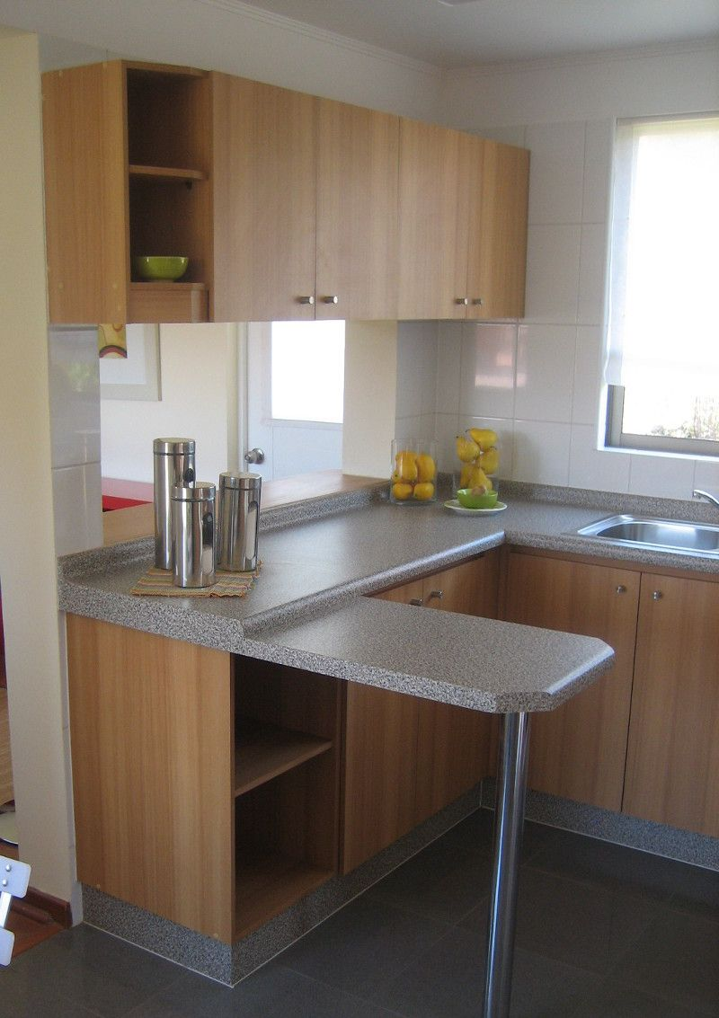 Los muebles con colores matizados muestran calidez en for Muebles modulares de cocina baratos