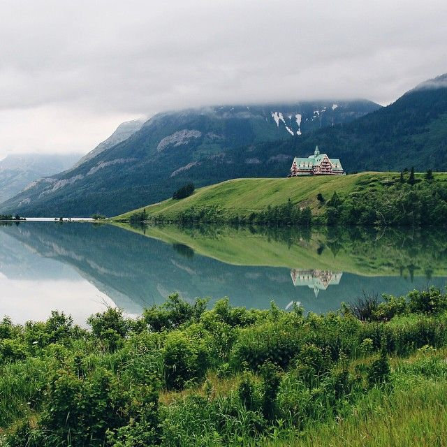 Misty morning on the edge of the Waterton Lakes.  Photo by @maurice for @travelalberta.  #stayandwander