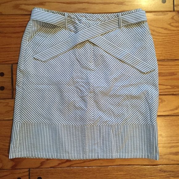 Adorable Seersucker Blue/White Skirt Adorable seersucker skirt in great condition! Size 10, tie in the front and perfect for spring! Josephine Chaus Skirts Midi