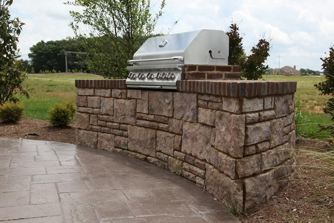 Stainless Grill Built Into Stone And Brick Small Half Circle Wall Backyard Grilling Backyard Outdoor Kitchen