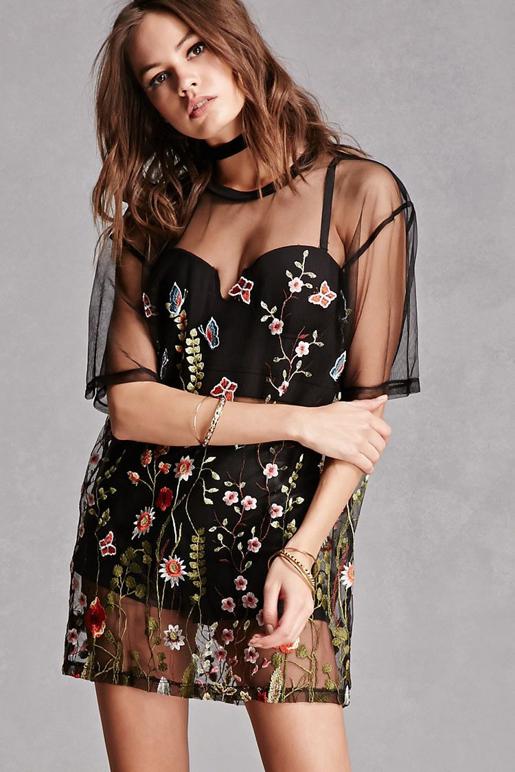 1c3638674acf1 A semi-sheer mesh tee by Jaded London trade  featuring an allover floral  and butterfly embroidery