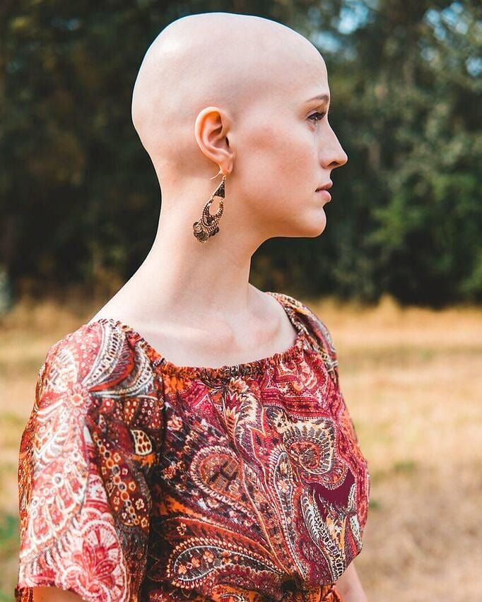 With her head shaved, henti figures