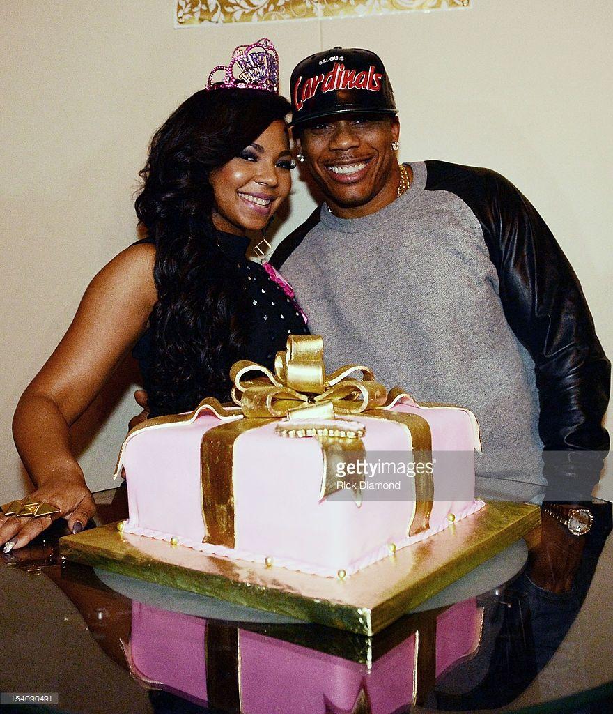 Ashanti and Nelly Photos Photos - Ashantis Surprise