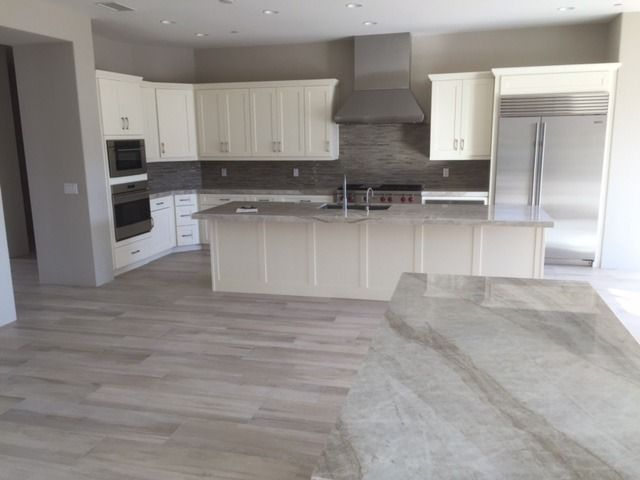Aequa wood look porcelain tile, Taj Mahal quartzite countertops and ...