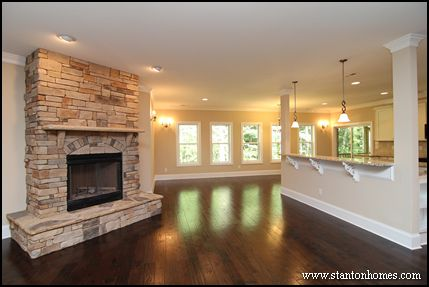 One Story Home With A Full Height Stone Fireplace And Wrap