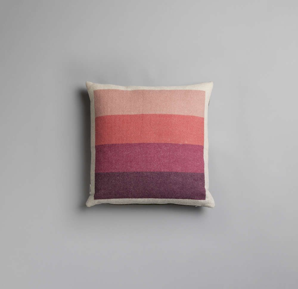 Åsmund blankets and pillows has clean geometric shapes that are