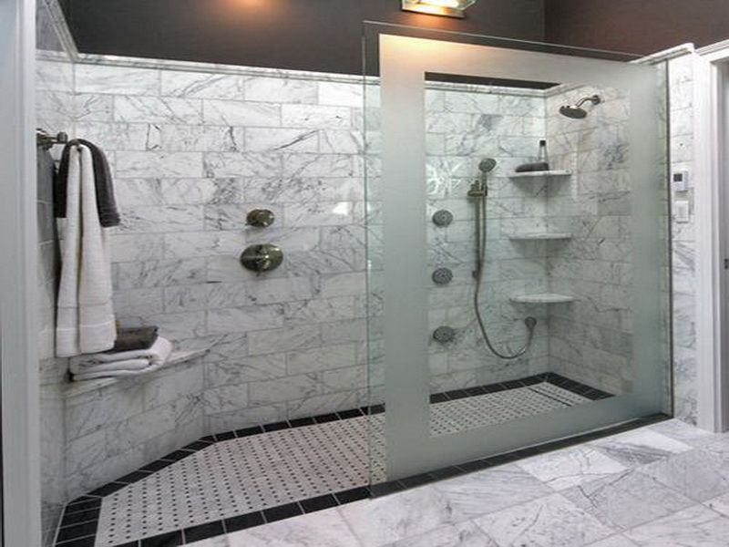 Here s a large walk in shower that has no doors  only decorative privacy
